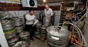 Summit Inn  owners Thomas and Tommy Gaffney:  beer kegs will go out of date before Covid-19 restrictions are lifted. Photograph: Alan Betson