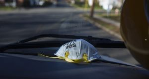 An N95 protective mask sits on the dashboard of an ambulance in Teaneck, New Jersey. Photograph: Angus Mordant/Bloomberg