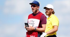 Tommy Fleetwood with his caddie Ian Finnis during the Honda Classic in March. Photograph:  Matt Sullivan/Getty