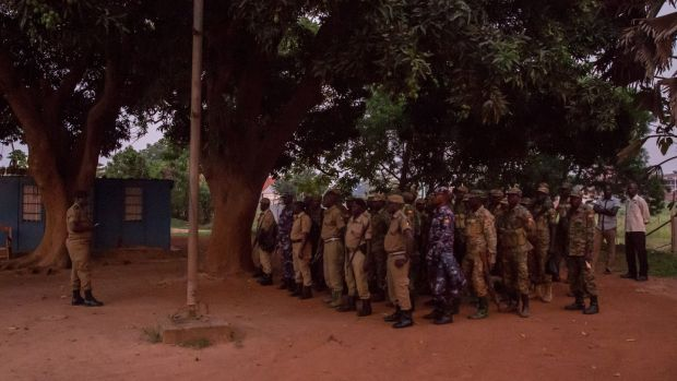 Soldiers at the central police station in Gulu, northern Uganda, ahead of the 7pm coronavirus curfew. Photograph: Sally Hayden