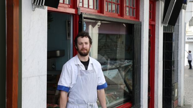 "Ben Flynn of O'Flynn's Butchers, Waterford. ""It's sad seeing the town like this. It's weird. The only thing I can liken it to is Christmas day, but it's like that every day now."" Photograph Nick Bradshaw"