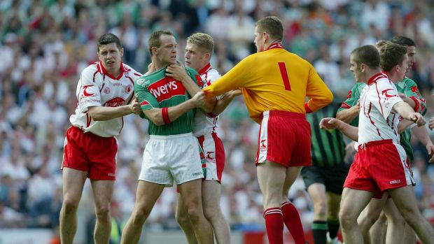 David Brady gets to grip with Tyrone in the 2004 All-Ireland quarter-finals. Photograph: Morgan Treacy/Inpho