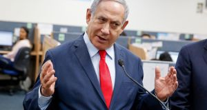 Israeli Prime Minister Benjamin Netanyahu delivers a speech during a visit to the Corona virus outbreak. Photograph:  Gil Cohen Magen/AFP