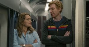 Merritt Wever as Ruby with Domhnall Gleeson as Billy, on a train from New York to Chicago in Run