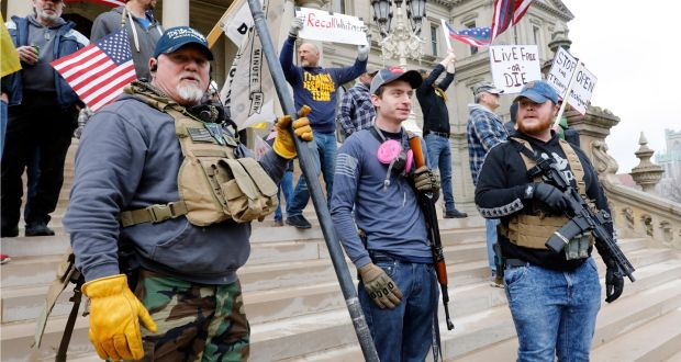 Protesters at the  'Michiganders Against Excessive Quarantine' at the Michigan State Capitol in Lansing. Photograph: JEFF KOWALSKY/AFP via Getty Images