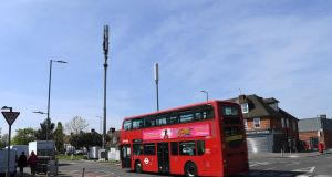 A burned down mobile phone mast in London, where authorities are  increasingly concerned about the impact of conspiracy theories linking coronavirus to 5G networks. Photograph: Facundo Arrizabalaga/EPA