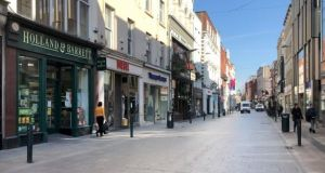 A view of a practically deserted Grafton Street due to Covid-19 restrictions. Photograph: Bryan O'Brien