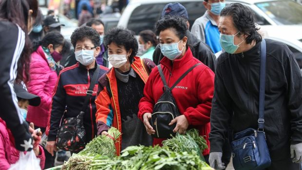Residents wearing face masks buy vegetables at a market in Shenyang in China's northeastern Liaoning province on April 17th, 2020. Photograph: STR/AFP via Getty Images.