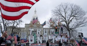 Supporters of the Michigan Conservative Coalition protesting  at  the state's extended stay-at-home order outside the state capitol in Lansing. Photograph:  Reuters/Seth Herald