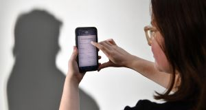 A person uses the Australian government's coronavirus-tracking app. Photograph: Darren England/EPA