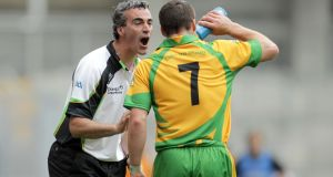 Donegal Manager Jim McGuinness speaks to Kevin Cassidy during the All-Ireland quarter-final in 2011. Photo: Morgan Treacy/Inpho