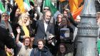 A crowd of supporters surround John Waters and Gemma O'Doherty outside the Four Courts following their High Court action. Photograph: Collins Courts