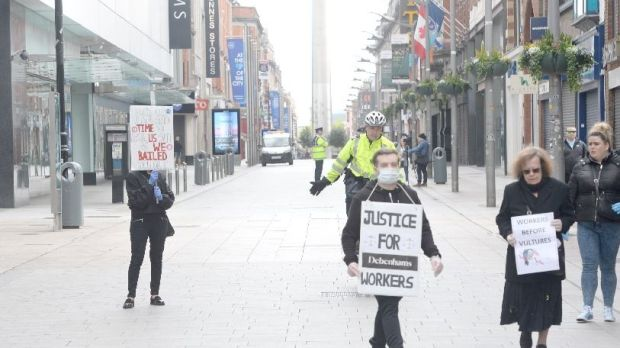 Debenhams workers gathered to protest outside the store on Henry Street, Dublin, were asked to move by gardaí. Photograph: Dara Mac Dónaill