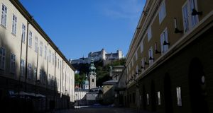 Deserted: St Peter's Abbey church, Hohensalzburg Castle and the festival house (Festspielhaus)  in Salzburg, Austria, on Wednesday. Photograph: Leonhard Foeger/Reuters