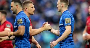 Munster's Andrew Conway shakes hands with Leinster's Nick McCarthy after last year's Pro14 semi-final. File photograph: Inpho