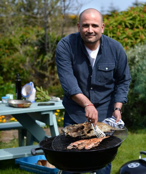 Niall Sabongi barbecuing fish in Howth, Co Dublin. Photograph: Dara Mac Dónaill/The Irish Times