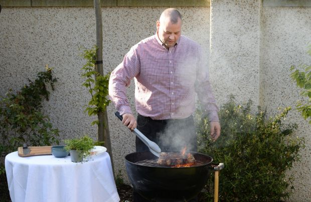Gaz Smith cooking T-bone steak over a barbecue. Photograph: Dara Mac Dónaill/The Irish Times