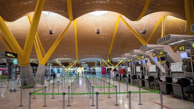 An empty Terminal 4 at Madrid-Barajas Airport. Photograph: Rodrigo Jimnez/EPA
