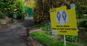 Covid 19 sign at St Stephen's Green: research shows mental health benefits from access to pleasant outdoor spaces. Photograph: Gareth Chaney/Collins