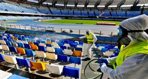 Operators of 'Napoli Servizi' sanitise the San Paolo stadium in Naples to prevent the dangers of the coronavirus. Photograph: EPA