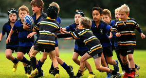Children play rugby in Auckland, New Zealand where the game is split on size and weight rather than age. Photo: Phil Walter/Getty Images