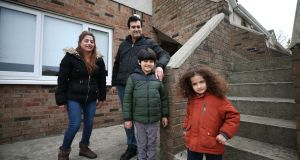 Sheno Mouradi with her husband and children: they were among the families who   exited homelessness in March. Photograph:   Nick Bradshaw
