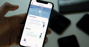 A Swiss app developed for proximity tracing: In Ireland a contract-tracing app will reportedly gather the phone number, age, gender and symptoms of people who believe they have the virus, and some location data. Photograph: EPA/Laurent Gillieron