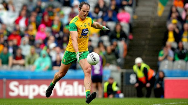 Donegal's Michael Murphy kicks the equalising point to draw the game against Kerry in last summer's quarter-final encounter at Croke Park. Photograph: Ryan Byrne/Inpho