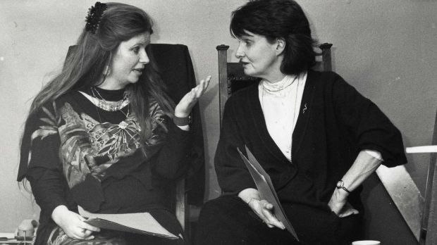 Poets Nuala Ní Dhomhnail (left) and Eavan Boland at the Mna na hEorpa poetry reading celebration by Irish women poets marking the occasion of International Women's Day in the Abbey Theatre attended by President Mary Robinson in 1992. Photograph: Matt Kavanagh