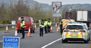 Gardaí at  the Border checking  for non-essential travel. Photograph: Charles McQuillan/Getty Images