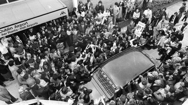 Crowds surround Johnny Logan's car at Dublin Airport on his return from winning the Eurovision in 1980. Photograph: Pat Langan