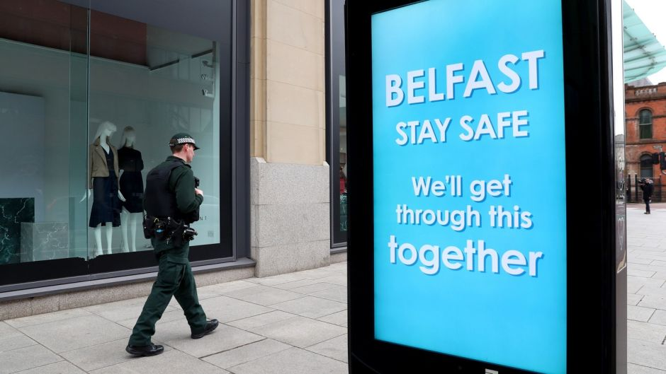 Photo issued by PSNI showing a PSNI officer on patrol in Belfast city centre during the Coronavirus pandemic restriction period. Photograph: Stephen Davison/PSNI/PA Wire