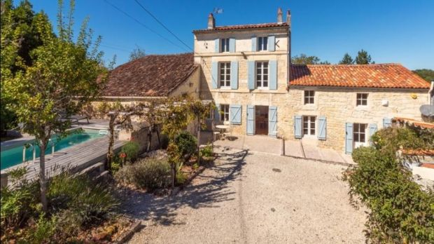 This renovated farmhouse in France comes with a swimming pool, separate unrenovated house, a workshop and garden
