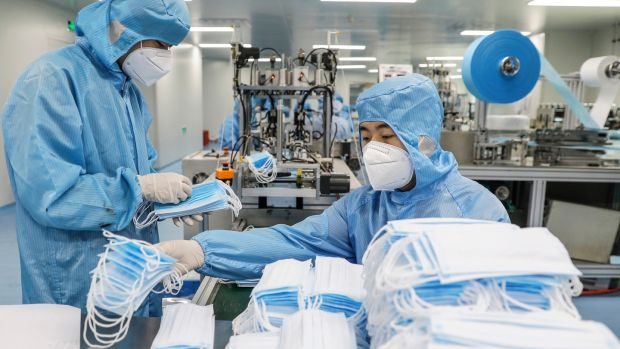 Face masks are produced at a factory of the Naton Technology Group in Beijing. Photograph: Wu Hong/EPA
