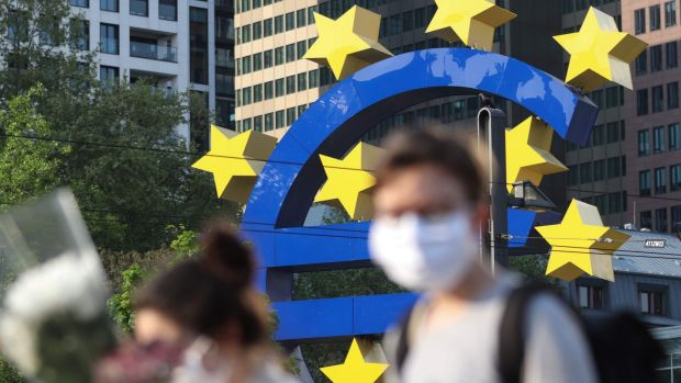 People in face masks in Frankfurt, pictured in front of the European Central Bank headquarters. Photograph: Yann Schreiber/Getty/AFP