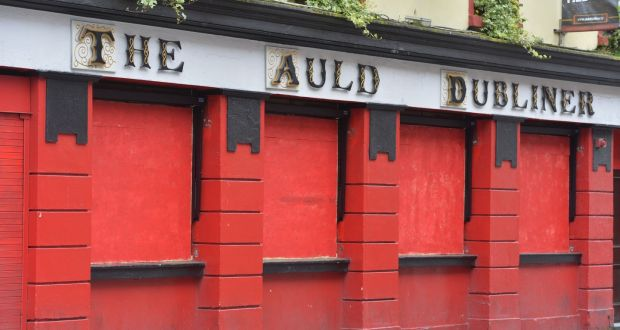 The Auld Dubliner Pub in Dublin's Temple Bar boarded up as Covid-19  restrictions remain in place. Photograph: Alan Betson / The Irish Times