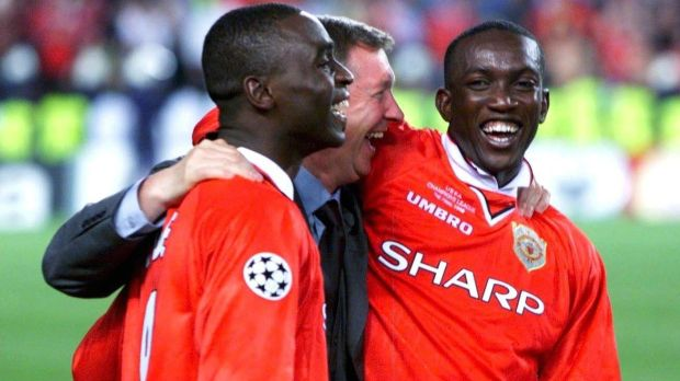 Happier times: Cole with Alex Ferguson and Dwight Yorke after winning the European Cup with United in 1999. Photo: Marcus Brandt/Bongarts/Getty Images