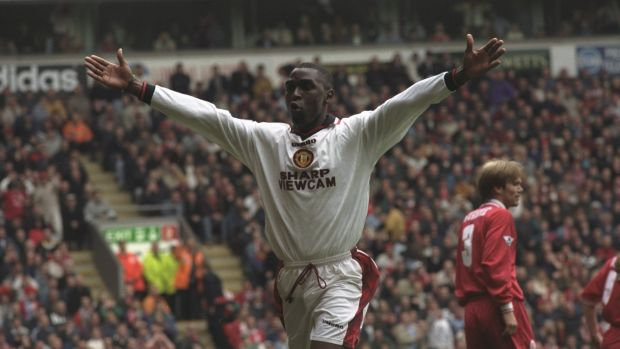 Cole celebrates scoring during United's 3-1 win over Liverpool in 1997. Photo: Ross Kinnaird /Allsport