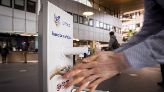 An antiseptic gel dispenser at the University Medical Center in Groningen, the Netherlands. The facility is the major hub of medical care in the northern Netherlands. Photograph: Vincent Jannink/ANP/AFP via Getty