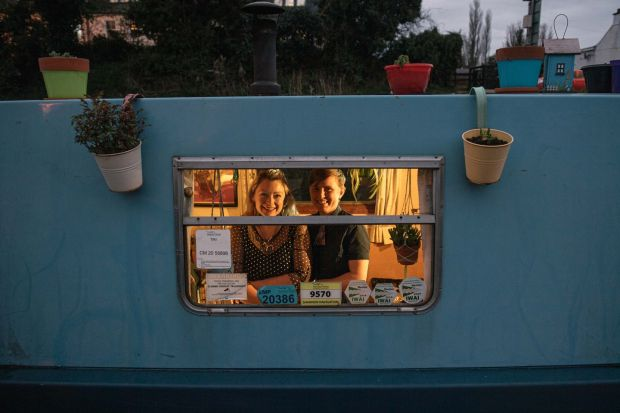 Claire and Ais on their houseboat. Photograph: Ruth Medjber.