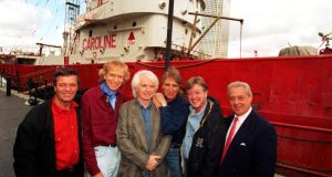 Ronan O'Rahilly, third from left, with former Caroline DJs Tony Blackburn, Tom Lodge, Johnnie Walker, Mike Ahern and Mark Sloane, on a visit to the Radio Caroline ship at Canary Wharf, London, in 1997. Photograph: Glen Copus/Evening Standard/Rex/Shutterstock
