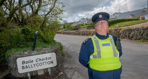 Garda Mick O'Brien in Ballycotton, east Cork:  'Traffic now is nearly non-existent... people aren't travelling since the full lockdown kicked in.' Photograph: Daragh McSweeney/Provision