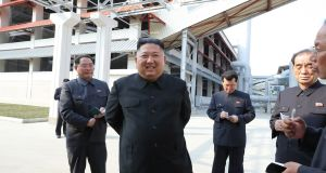 A photo released by the official North Korean Central News Agency (KCNA) shows North Korean leader Kim Jong-un attending a completion ceremony of a factory. Photograph: EPA/KCNA