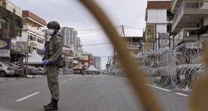 A member of the Malaysian Royal Armed Force guards a street in a neighbourhood that has been put under Enhanced Movement Control Order (EMCO) on May 1st, 2020 in Kuala Lumpur, Malaysia. Photograph: Rahman Roslan/Getty Images