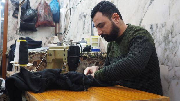 Ahmed Namiq Salim, a tailor working at al-Quds market on the east bank of the Tigris in Mosul. Photograph: Lorraine Mallinder