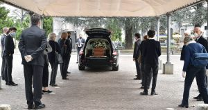 People respect the safety distance as they attend a funeral service. Photograph:  EPA/Alessandro Di Marco