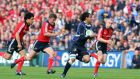 Leinster's Isa Nacewa gets past Ronan O'Gara Doug Howlett and Keith Earls of Munster during the 2009 Heineken Cup semi-final at Croke Park. Photograph: Dan Sheridan/Inpho
