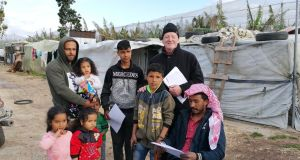 Fr William Stuart with Syrian refugees in camp near Tyre, Lebanon.