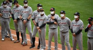 Hanwha Eagles players line up wearing face masks ahead of the opening game of South Korea's new baseball season. Photograph: Jung Yeon-Je/Getty/AFP