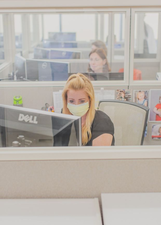 Post-pandemic workplaces: staff in cubicles at the infection-prevention office at the University of California, Irvine. Photograph: Alex Welsh/New York Times